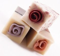 These homemade soaps look like they have roses in them.