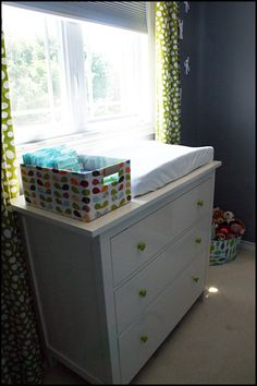 Great changing table idea.  Like the drawer knobs!