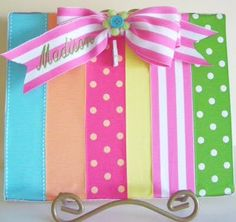 """""""picture frame"""" made out of ribbon scraps. tiny clothespin at the top holds the picture"""