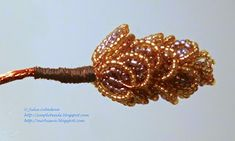Free detailed tutorial with step by step photos on how to make conifer cones out of seed beads and wire in French bead looping technique. Great for beginners!