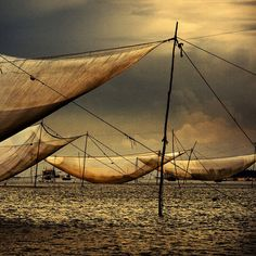 Large fishnets suspended over the river, close to Hoi An, Vietnam.