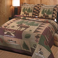 This Moose Lodge quilt set has it all. Big game, duck, salmon and bear tracks make this bedding set ideal for any cabin or country decor.