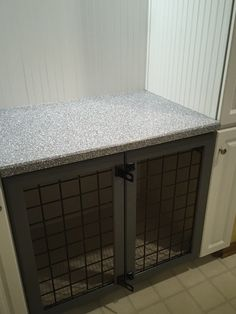 Turn a laundry room closet into a built in dog crate with cabinetry to hold dog items.