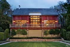 A red barn in Bucks County, Pennsylvania is transformed into a 4,000-square-foot space for entertaining
