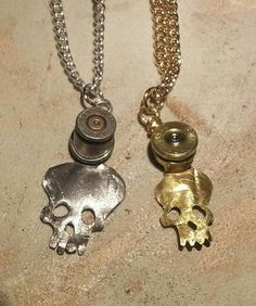Bullet casing pendants. But different!!! Folded open and flattened, cut into shape. $40. Wonder if I could do this with the tools I have...