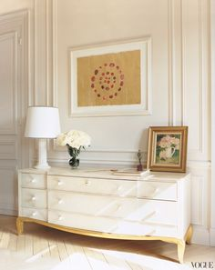 A Jade Jagger watercolor of rose petals in concentric circles is displayed above an armoire by André Arbus.