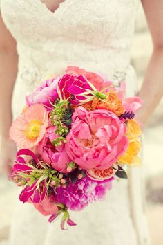 Bright pink peonies, orange ranunculus, fuchsia gloriosa lilies, coral poppies, lavender sprigs and carnation clusters. #bouquet