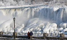 Niagra freezes! Visitors look at the frozen falls on the US side of Niagara Falls l Photograph: Dan Cappellazzo/Barcroft USA