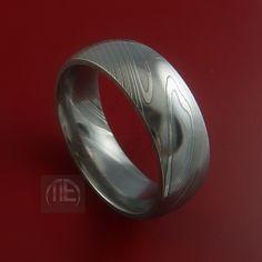 Damascus Steel Ring Wedding Band Genuine Craftsmanship Any Size. $208.92, via Etsy.