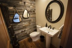 Program bathrooms don't have to be hideous.Try Stikwood Peel and Stick Wood Wall Planking to cover up a boring or ugly wall!