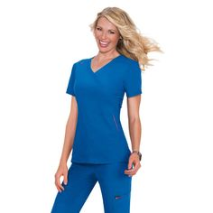 Beautiful blue Koi Lite Philosopy Scrub Top. The material used for this top is moisture wiking, stretchy, easy wash and wear and wrinkle free. The top has rib knit trim on the side for extra comfort and a bungee loop for your ID badge on the shoulder. £29.99   #medicalscrubs #nursescrubs #dentistscrubs #nurses #dentists #bluescrubs #nurseuniform