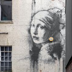 """Lots of artists have been inspired by Vermeer's Girl with a Pearl Earring. Like graffiti artist #Banksy. His """"Girl with a Pierced Eardrum"""" can be found in #Bristol. #Mauritshuis #TheHague #Art #girlwithapearlearring #vermeer #meisjemetdeparel #graffiti #graffitiart #mygirlwithapearl  Photo: Time - Paul Green"""