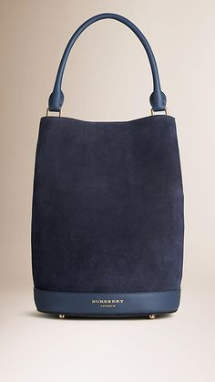 ^Burberry Navy The Bucket Bag in Suede - The Bucket Bag in English suede. Inspired by the runway, the design is made in Italy with hand-finished details. A detachable matching wristlet features inside. Discover the women's bags collection at Burberry.com