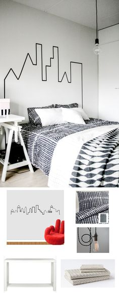 """A minimalist outline of a city skyline provides the perfect """"headboard"""" for this bedroom space."""
