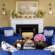 Vibrant cobalt armchairs and matching sofa stand out against the neutral setting.
