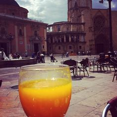 Drinking oranje juice at breakfast in Plaza de la Virgen, Valencia Spain