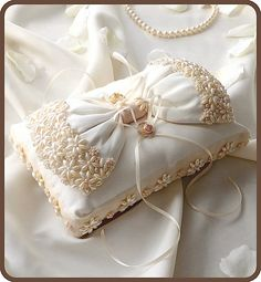 Ring pillow with ribbon decorated with pearls