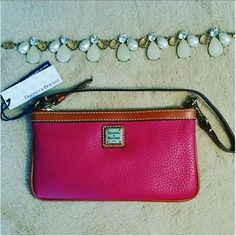 """Dooney & Bourke Strawberry Wristlet Strawberry pink leather wristlet with registration card inside. 4.5"""" by 8"""", has 15"""" leather strap (length when detached, approximately a 7.5"""" drop when hooked to zipper). Perfect condition, color is most like third picture. There is a divider inside for two separate sections. Gold hardware. Dooney & Bourke Bags Clutches & Wristlets"""