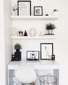 white floating shelves with a matching small desk bring perfect symmetry