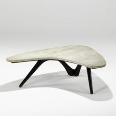 Vladimir Kagan; Walnut and Travertine Coffee Table for Kagan-Freyfuss, 1950s.