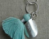 Pale Green Tassel with Silver Curve Pendant £21