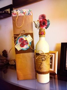 DIY Wine Bottle  -spray painted wine bottle wrapped in burlap and jute with key accent. Skip the buttons and paper flowers