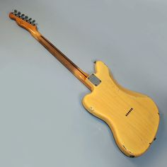 Fender Telemaster is a combination of a Telecaster and a Jazzmaster