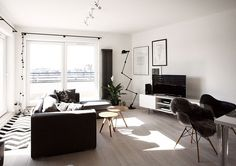 Beautiful living room of the scandinavian style apartment in Warsaw Scandinavian Home Decor Mixed With a Minimalist Use of Wood in Warsaw