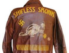 """The artwork on this jacket depicts Hitler as a """"Shifless Skonk."""" The """"Schifless Skonk,"""" misspelled on R.L. Parker's jacket, was the name of a B-17G bomber of the 568th Bomb Squadron. The swastika marks a German aircraft destroyed, while the parachuter indicates Parker had to jump. From Arthur Hayes' collection."""