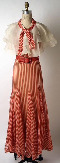 """Striped evening ensemble (dress, belt, cape, slip) by Norman Norell for Hattie Carnegie, Inc., American, 1932. Label: """"Hattie Carnegie"""""""