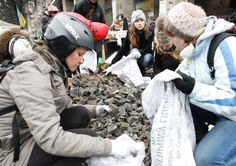 Protesters filling bags to build new barricades during clashes with police in...