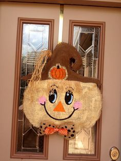 Fall burlap scarecrow door hanger by shutthefrontdoors on Etsy Burlap Projects, Burlap Crafts, Wreath Crafts, Craft Projects, Scarecrow Crafts, Scarecrows, Burlap Door Hangings, Fall Carnival, Fall Door Hangers