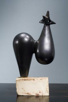Sculpture (1952) by French ceramic sculptor Georges Jouve (1910-1964). Black enameled ceramic, 18 x 8 x 5 in. via Galerie Philippe Jousse