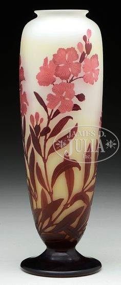 "GALLE FLORAL CAMEO VASE. Galle vase is decorated with cameo maroon colored leaves and stems leading to acid carved pink cameo flowers all set against a light yellow shading to cream frosted background. Signed on the side in cameo ""Galle""."