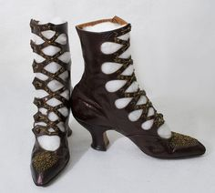 Cross-Strap Boots: ca.1900-1905, kidskin leather with iridescent metallic finish, leather soles, metallic bead embellishment, Louis XV heels.