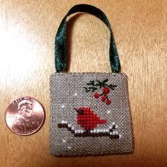I originally found this little baby cardinal cross stitch on Pinterest but there was no pattern.  I made my own and changed it a little.  It's so small and so quick to work up.  I think I'm going to make a baby blue bird too.  Thanks to whoever stitched my inspiration one.    ~allison