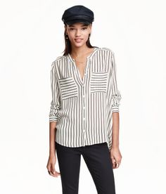 Check this out! V-neck blouse in woven crêpe fabric. Shoulder tabs, chest pockets, and long sleeves with roll-up tab and button. Rounded hem, slightly longer at back. - Visit hm.com to see more.