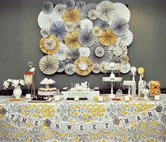 Ahh, palette of grey, yellow, & white . . . how I absolutely love you.  And vintage fabric tablecloths & ornate white chandelier style desse...