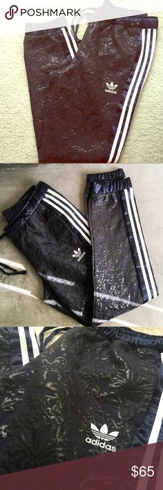 """Embroidered Adidas Original Track/Jogger Pants Rare Adidas Original embroidered track/jogger pants in navy blue color. Inseam: 29"""", waist: 16"""" (laid flat). Half lined. Can be unisex: Size M Men or Women Size L. One of a kind piece. Like new condition. Adidas Pants Track Pants & Joggers"""