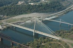 The East Huntington Bridge is a cable-stayed bridge crossing the Ohio River at Huntington, West Virginia. It carries WV 106 on the West Virginia approach and OH 775 on the Ohio approach Weirton West Virginia, Huntington West Virginia, Virginia Homes, Steubenville Ohio, Places To Travel, Places To Visit, Cable Stayed Bridge, The Buckeye State, Ohio River