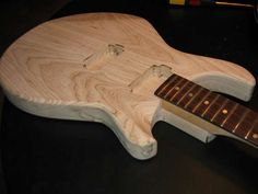 Building a guitar sounds like the raddest freaking project! I think I might try and do this with my little sister someday since she is super into music and building things and so I can use her tools and garage :)