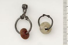 Birka, grave 570. Silver, amber, glass.