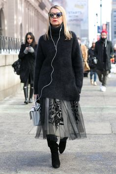 Natalie Joos perfected boy-meets-girl style with her oversize sweater and tulle midi skirt.
