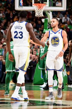Draymond Green and Stephen Curry of the Golden State Warriors high five during the game against the Boston Celtics on November 16 2017 at the TD...