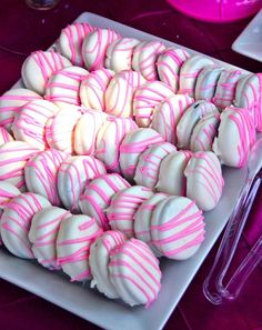 No recipe but just take your favorite Oreo cookie, dip it in white chocolate and drizzle colored icing on top. Make any color(s) you want.  Perfect for baby or bridal shower treats!