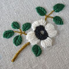 White wool flower embroidered on linen. [by Yumiko Higuchi]
