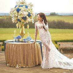 Sheer sophistication with a gold and blue color scheme is #ontheblog to ignite your wedding planning. Stylist: @missmunrostylist | :camera:: @MuseMotionPictures | Dress: #ZuhairMurad courtesy of @TheWeddingClub1 | Tablesetting: @Intricate_Create