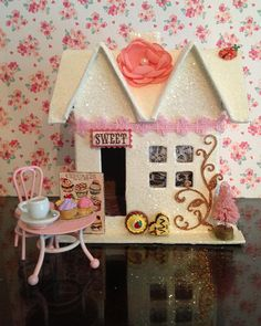 Glitter Sweet Shop. This little sweet shop is an ivory color (not pure white). It has a soft pinky apricot flower on the roof and a little ladybug.  #fairyvalentine