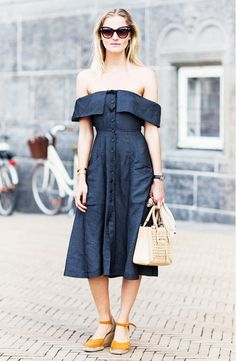 Amanda Norgaard wears an off-the-shoulder dress by Reformation with a small nude leather satchel, cat-eye sunglasses, and espadrilles