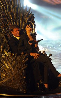 Lena Heady & Sean Bean get comfy on the Iron Throne.